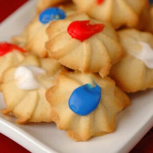 A plate of red, white, and blue colored Ukrop's Butterstar Cookies.